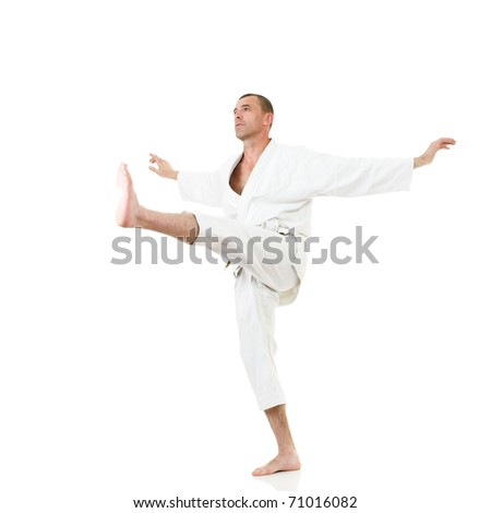 Mid-adult man dressed in traditional kimono demonstrating martial arts combat #71016082
