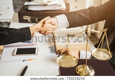 The hard work of an asian lawyer in a lawyer's office. Counseling and giving advice and prosecutions about the invasion of space between private and government officials to find a fair settlement. Royalty-Free Stock Photo #710218210