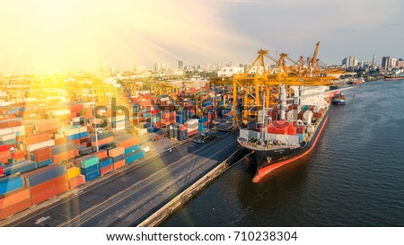container,container ship in import export and business logistic,By crane,Trade Port , Shipping,cargo to harbor.Aerial view,Water transport,International,Shell Marine,transportation,logistic,trade,port #710238304