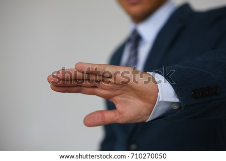 Gesture male hand rejection says no male businessman in a suit on a gray background I will not categorically claim #710270050
