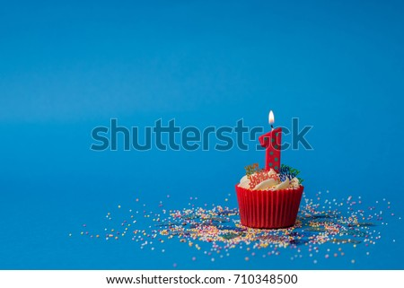1st birthday candle Royalty-Free Stock Photo #710348500