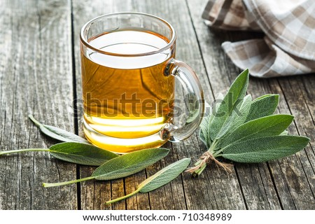 Sage tea and sage leaves. Infusion made from sage leaves. Medicinal  herb Salvia officinalis. #710348989
