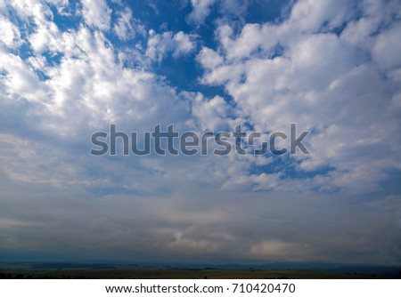 Bright blue sky with white clouds #710420470
