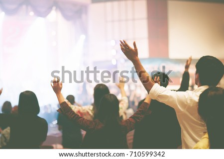 Christian worship with raised hand,music concert