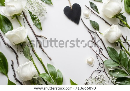 Creative mock up of accessories and flowers on a white background. A gentle and romantic concept. View from above. #710666890
