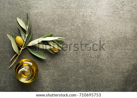 Olive oil and olive branch on the gray table #710695753