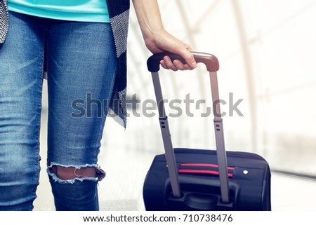 woman walking with suitcase at airport terminal #710738476
