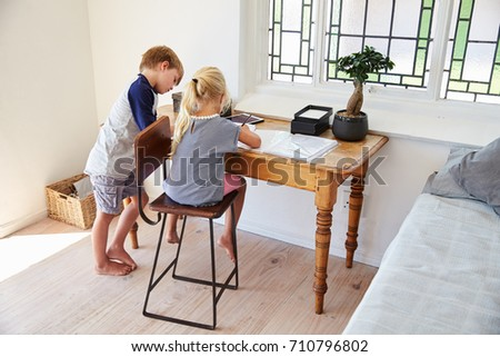 Boy And Girl In Bedroom With Digital Tablet Doing Homework #710796802