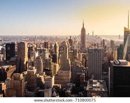 New York City skyline with urban skyscrapers at sunset in dark tone #710800075