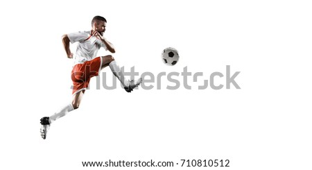 Soccer player on a white background. Isolated soccer player in un-brand clothes. #710810512