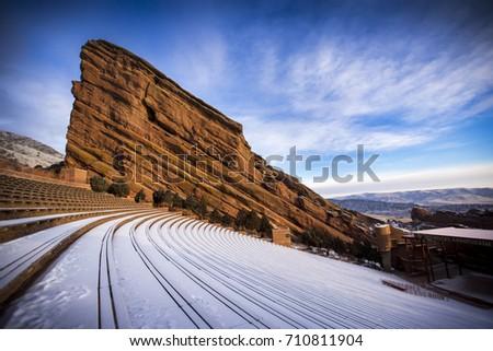 A fresh blanket of snow covers Red Rocks near Denver, Colorado #710811904