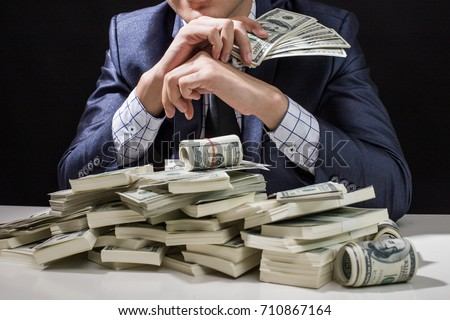 Man holding Money in hand at Black Background, Man receive a lot Money from Trading, Business Success Concept.