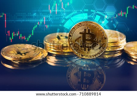 Bitcoins and New Virtual money concept.Gold bitcoins with Candle stick graph chart and digital background.Golden coin with icon letter B.Mining or blockchain technology #710889814