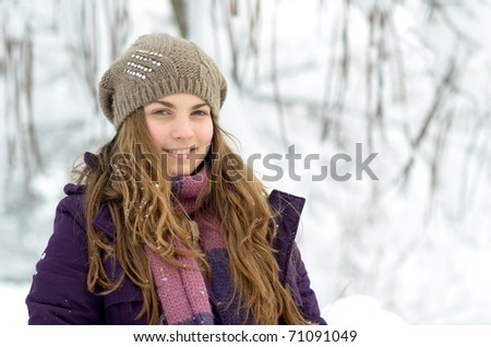young woman enjoying the snow #71091049