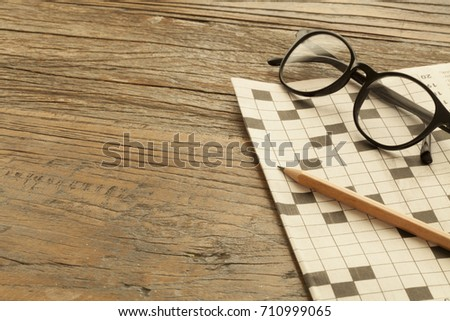 crossword at newspaper with coffee #710999065