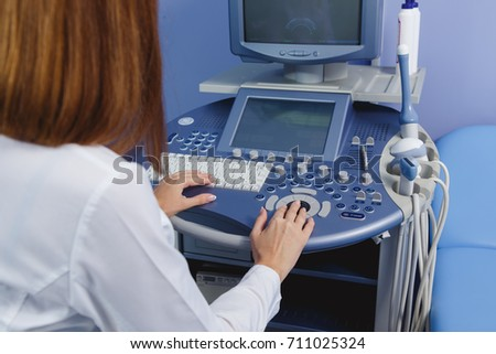 Hands of a doctor who uses the medical ultrasound diagnostic machine #711025324