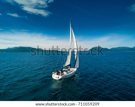 Aerial view of sailing yacht in Norway Royalty-Free Stock Photo #711059209