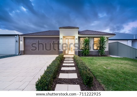 Front elevation of a new modern Australian style home. #711222925