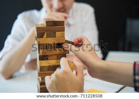 man and woman play wood material toy block for develop thinking and activity #711228508