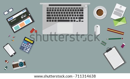 Top view of table working and working desk with accessory on the wooden floor and laptop, desk top, notebook, camera, pencil, pen, ruler, calendar, letter, coffee cup, calculator, printer, glasses #711314638