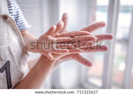 family hands together, family members hands, parents with one child, family with one child #711322627