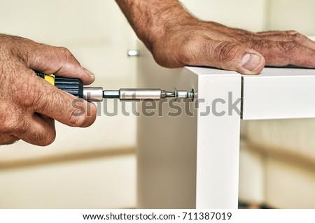 Assembling a furniture close-up                                #711387019
