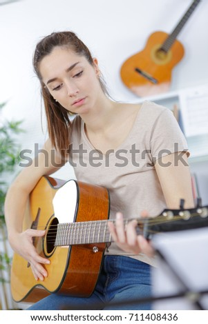 pretty teen girl playing guitar #711408436