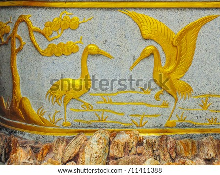 The artworks at thai Buddhism temple .Showing a pair of bird enjoing in natural environment.The work is below the base of Buddha image at Wat Chanasongkram. completely free from copyright obligation.
