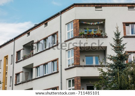 white building with orange brick balcony #711485101