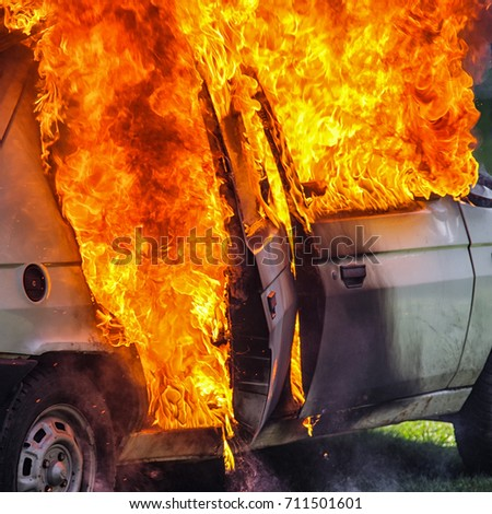 Burning car after accident on road. Flames and fire #711501601