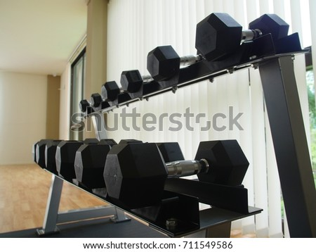 Close up of dumbbells in the gym, weight training equipment #711549586