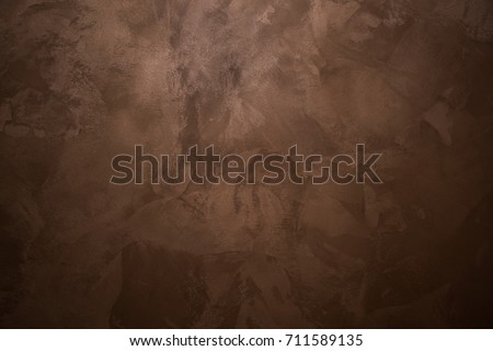 Background. Brown, chocolate paint on the wall. Rough strokes of the master. Royalty-Free Stock Photo #711589135