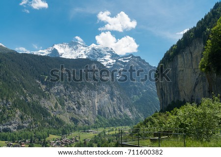 Spectacular mountain views and hiking trail in the Swiss Alps landscape near Stechelberg the district of Lauterbrunnen, Switzerland #711600382