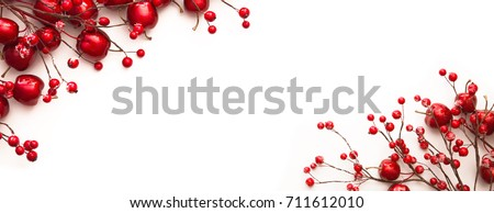 Christmas decoration with red apples and berries isolated on white Royalty-Free Stock Photo #711612010