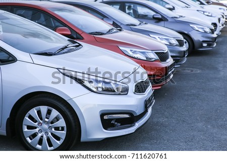 Cars For Sale Stock Lot Row. Car Dealer Inventory Royalty-Free Stock Photo #711620761