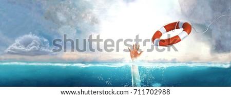 Thrown life buoy saving drowning person. Royalty-Free Stock Photo #711702988