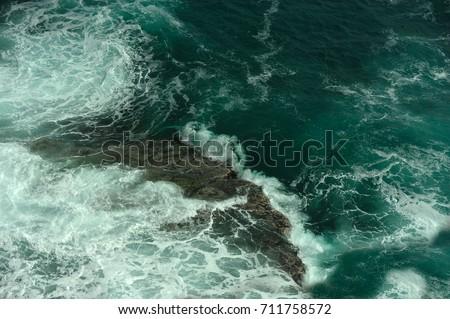 Sea wave. Underwater rock. Ocean waves. Sea foam. #711758572