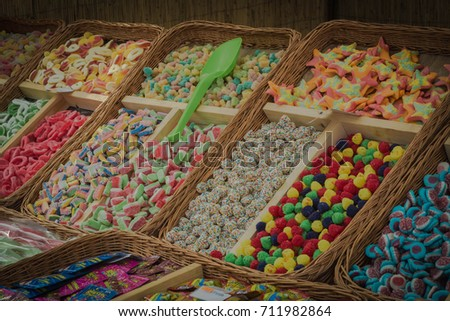 Lot of colorful sweets at the fair - dark version #711982864