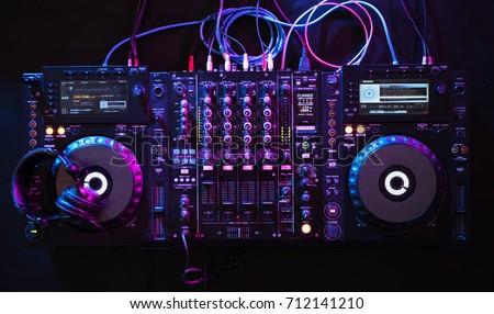Mixer equipment entertainment DJ station Royalty-Free Stock Photo #712141210