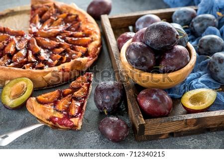 Homemade plum pie, autumn dessert with fresh plums, baking, healthy vegetarian food Royalty-Free Stock Photo #712340215