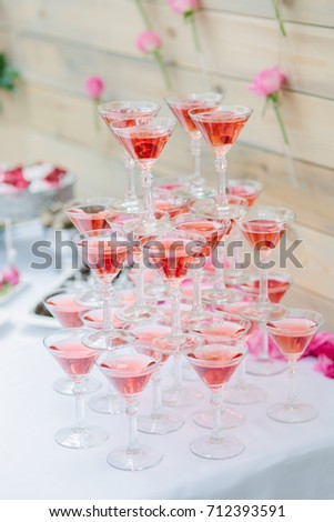 Arranged piles of glasses of champagne for guest's entertainment #712393591