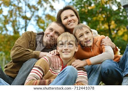 family posing  in park  #712441078