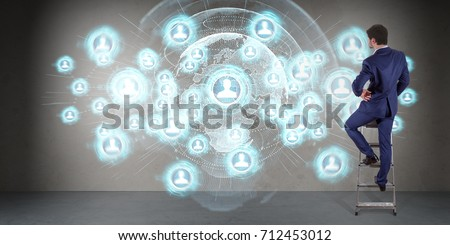 Businessman in modern interior using social network interface on a wall 3D rendering #712453012