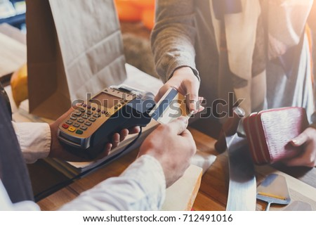 Retail, credit card payment service. Customer paying for order of cheese in grocery shop. Royalty-Free Stock Photo #712491016