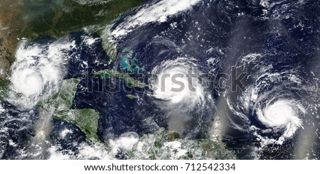 Overview of three hurricanes Irma, Jose and Katia in the Caribbean Sea and the Atlantic Ocean - Elements of this image furnished by NASA #712542334