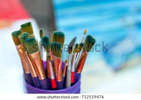 Brushes for drawing in a glass on a background of a picture #712559476