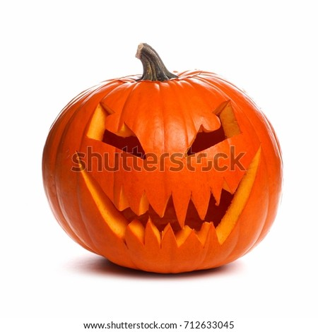 Spooky Halloween Jack o Lantern isolated on a white background #712633045