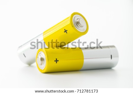 Two yellow AA size batteries isolated on white backgraound #712781173