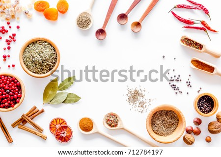 Colorful dry herbs and spices for cooking food white kitchen table background top view space for text #712784197