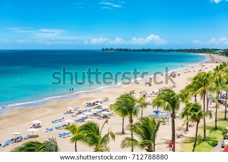 Puerto Rico beach travel vacation landscape background. Isla Verde resort in San Juan, famous tourist cruise ship destination in the Caribbean. Royalty-Free Stock Photo #712788880